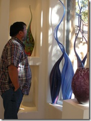 John looking at the blown glass